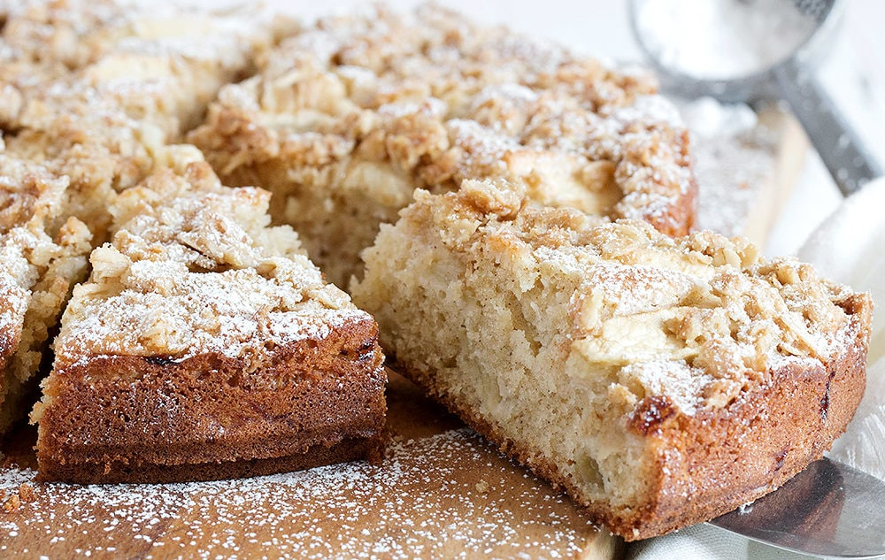 apple cake with crisp topping on cutting board