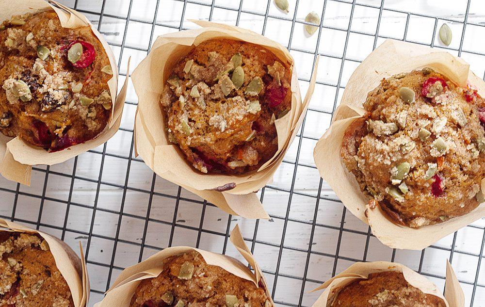 pumpkin cranberry muffins on cooling rack