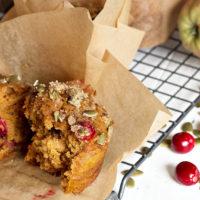pumpkin cranberry muffin on cooling rack