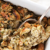 classic bread stuffing in casserole with spoon