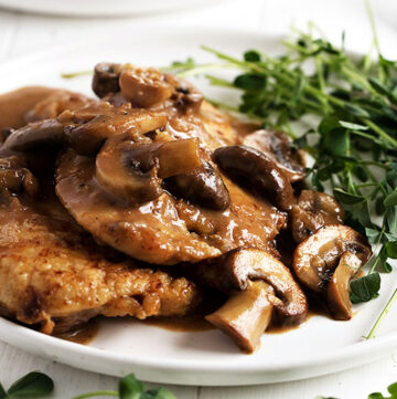 chicken marsala on plate with greens