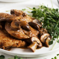 chicken marsala on white plate