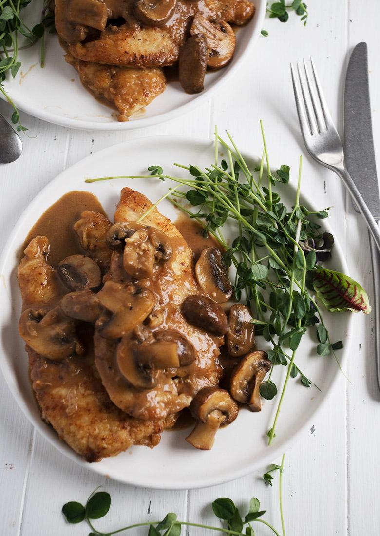 chicken marsala on white plate