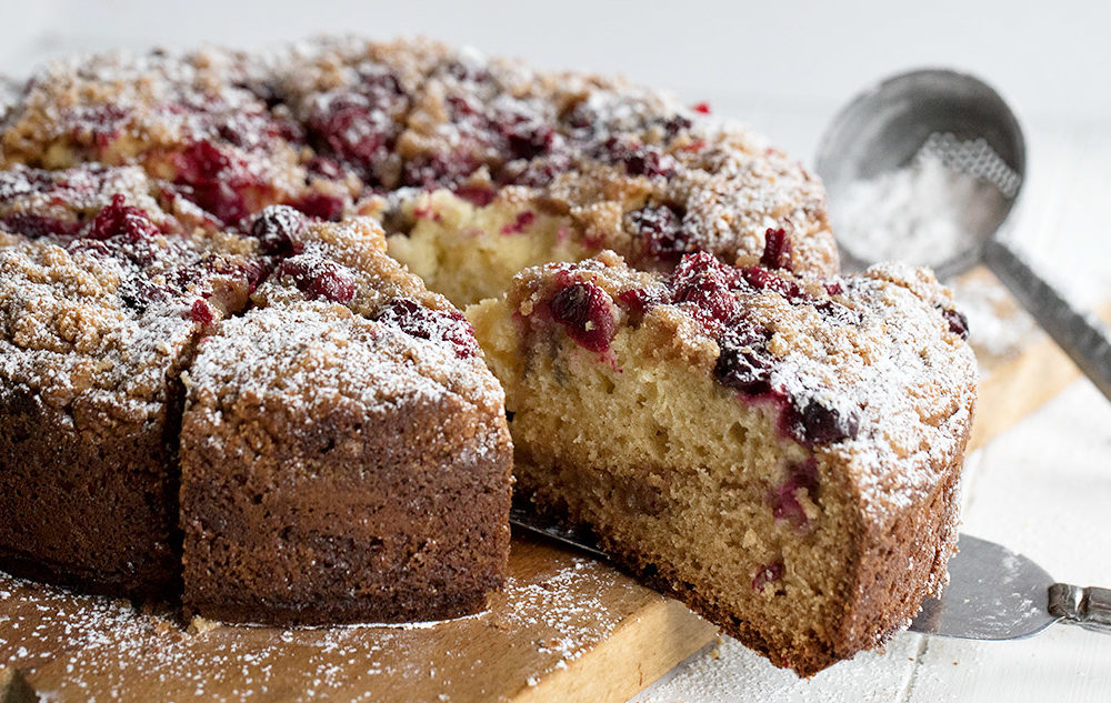 cranberry cake on cutting board