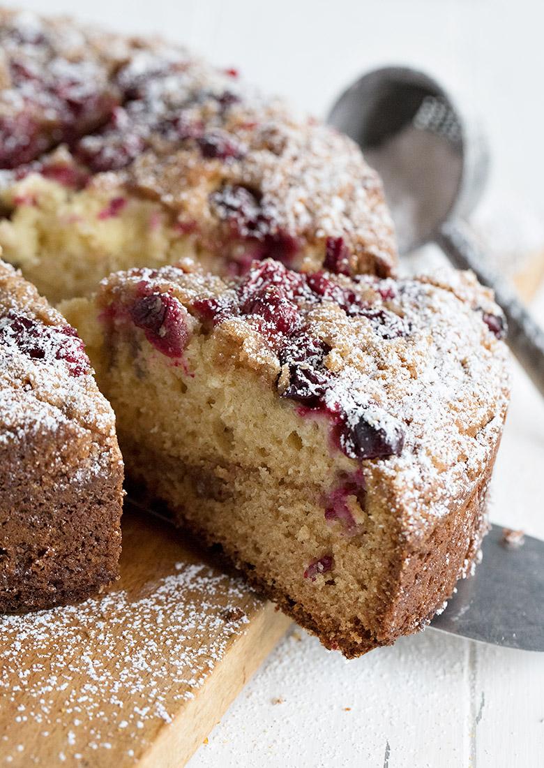 cranberry cake on cutting board