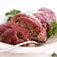 classic meatloaf sliced on white plate