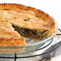 classic tourtiere in pie pan sliced