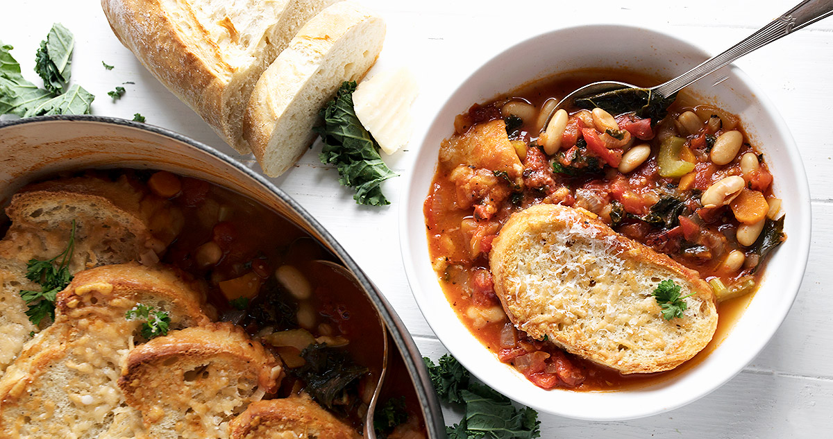 ribollita soup in bowl with bread slice on top