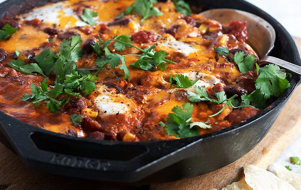 chili style shakshuka in a cast iron skillet