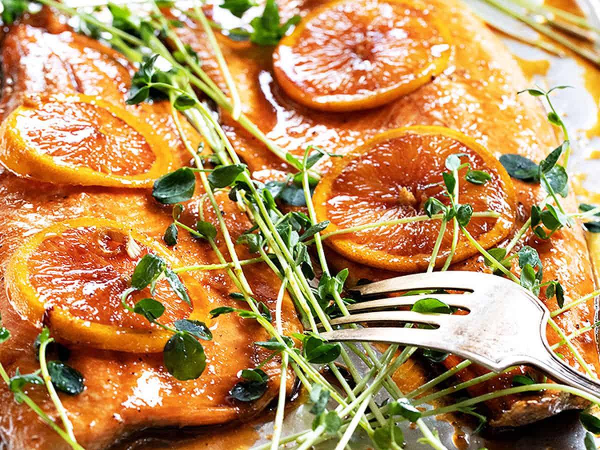 Asian orange salmon on baking sheet