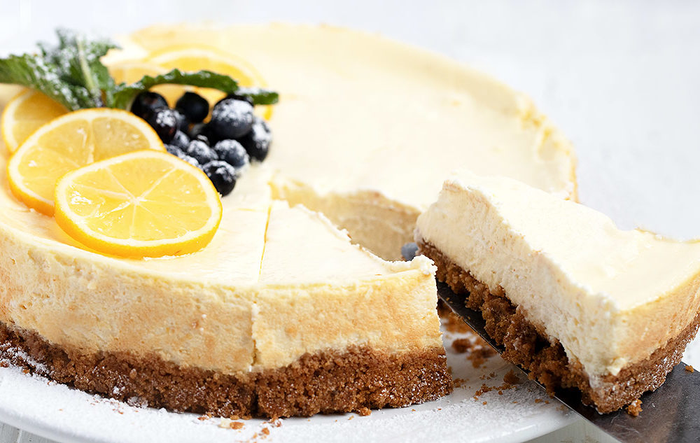lemon cheesecake sliced on white background