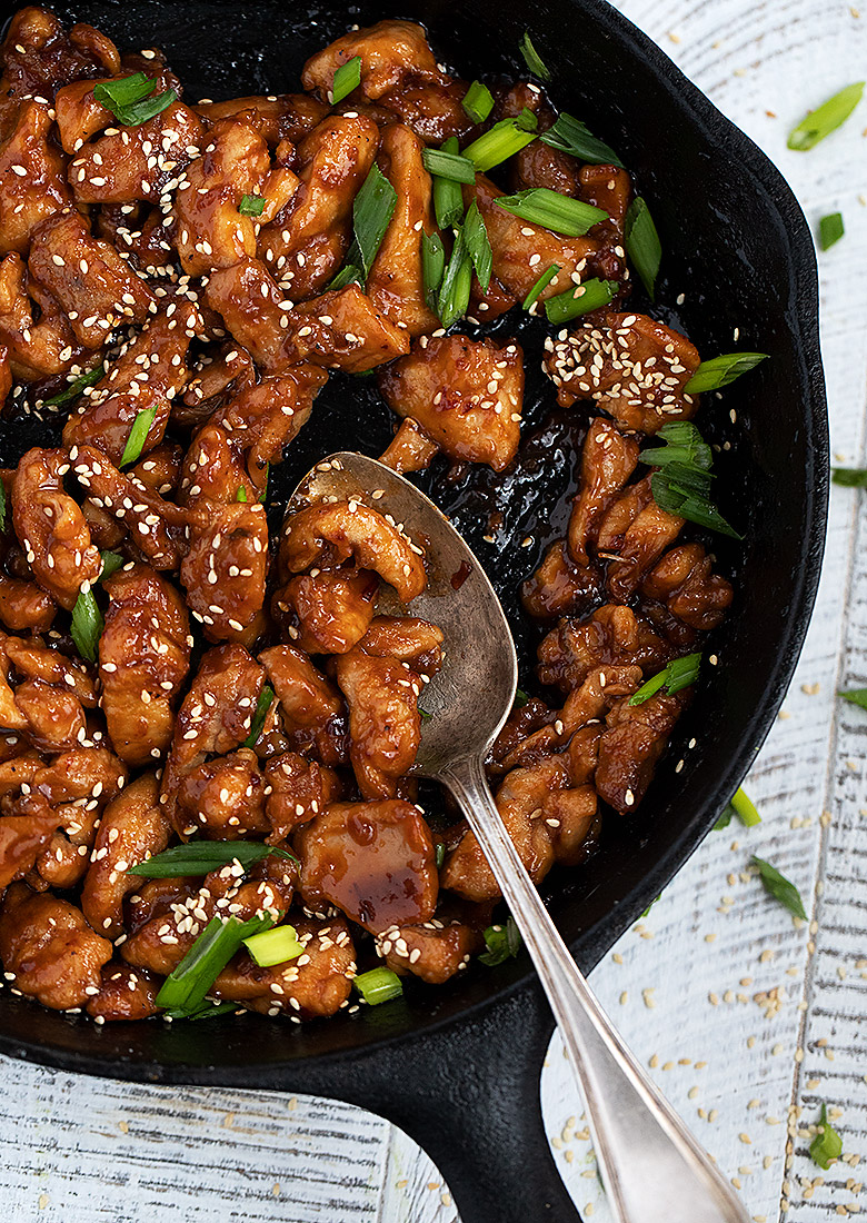 spicy chicken chunks in a cast iron skillet