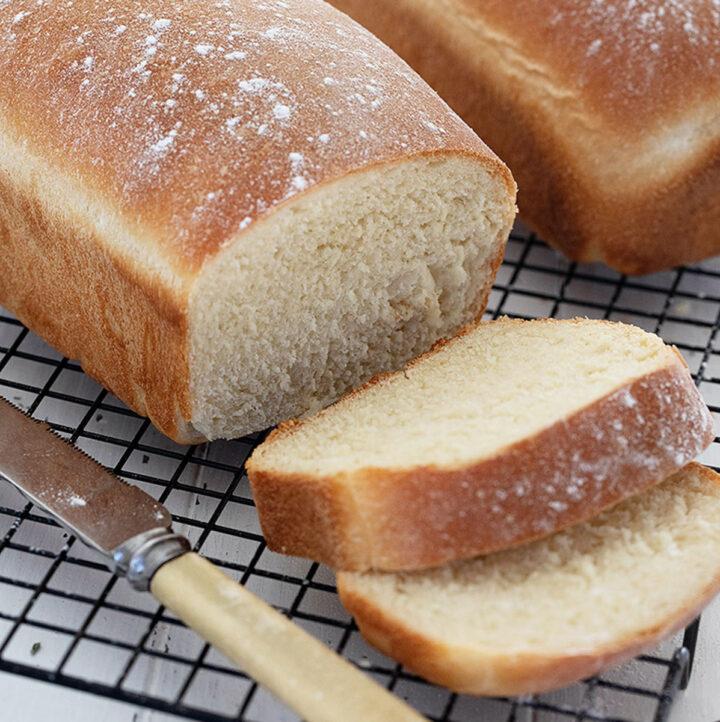 homemade white bread sliced on cooling rack