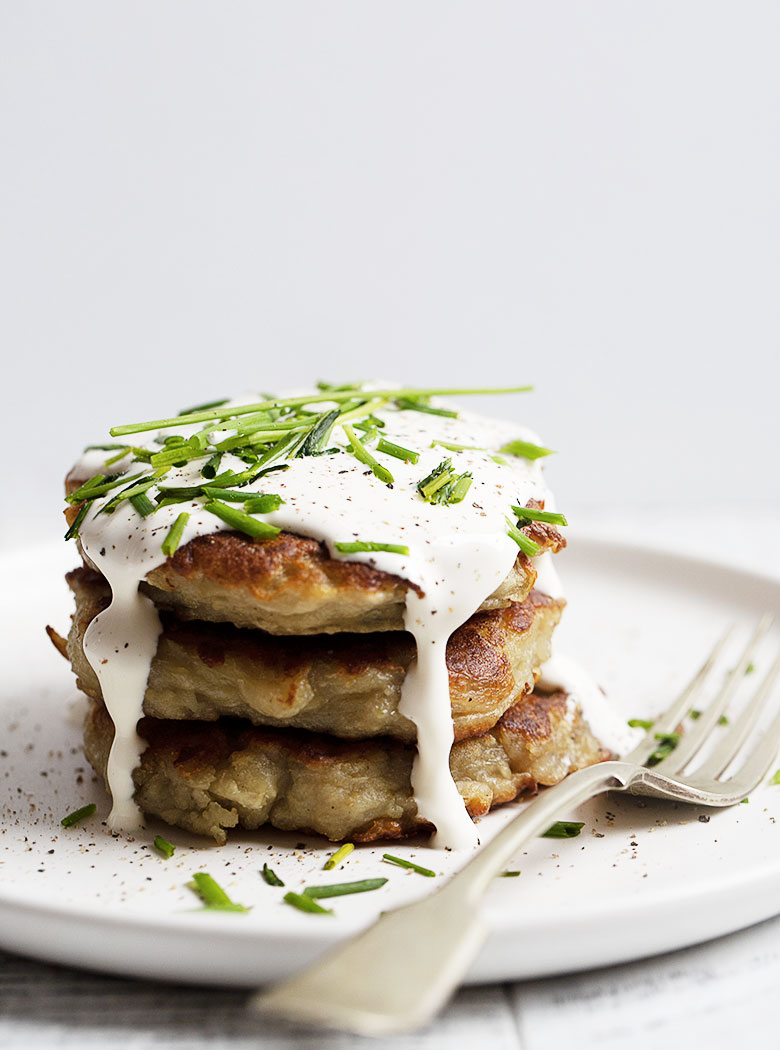 stacked boxty potato cakes on white plate with fork