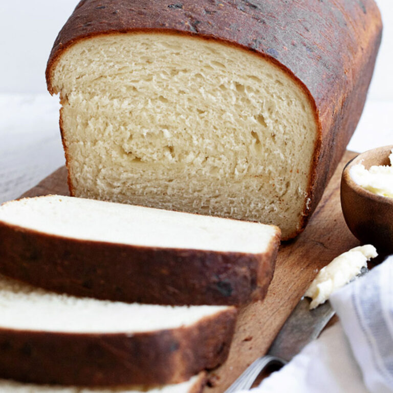buttermilk cheese bread sliced on cooling rack
