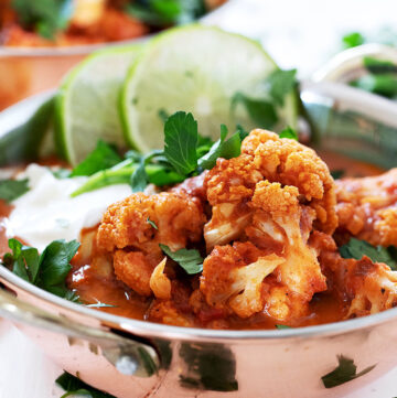 Indian cauliflower curry in copper bowls