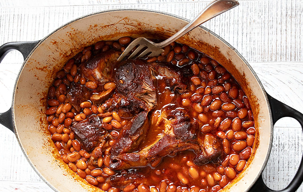 pork and beans in a Dutch oven