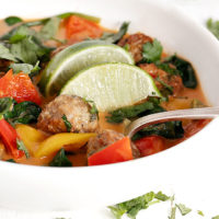 Thai chicken meatballs soup in white bowl