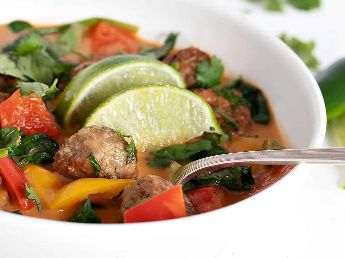 Thai meatball soup in white bowl