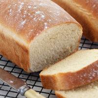 white homemade bread, sliced on cooling rack