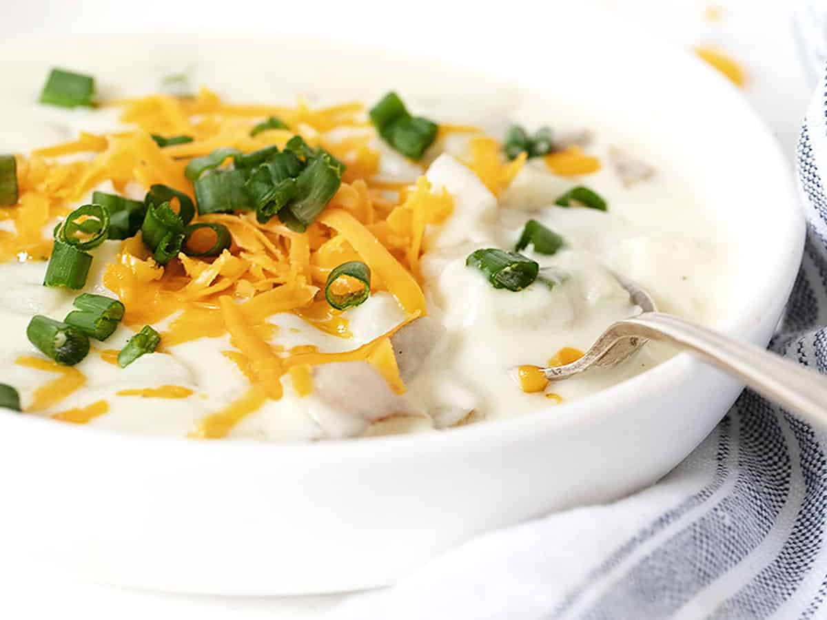 loaded baked potato soup in white bowl