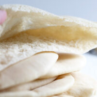 homemade pita breads sliced and showing pocket