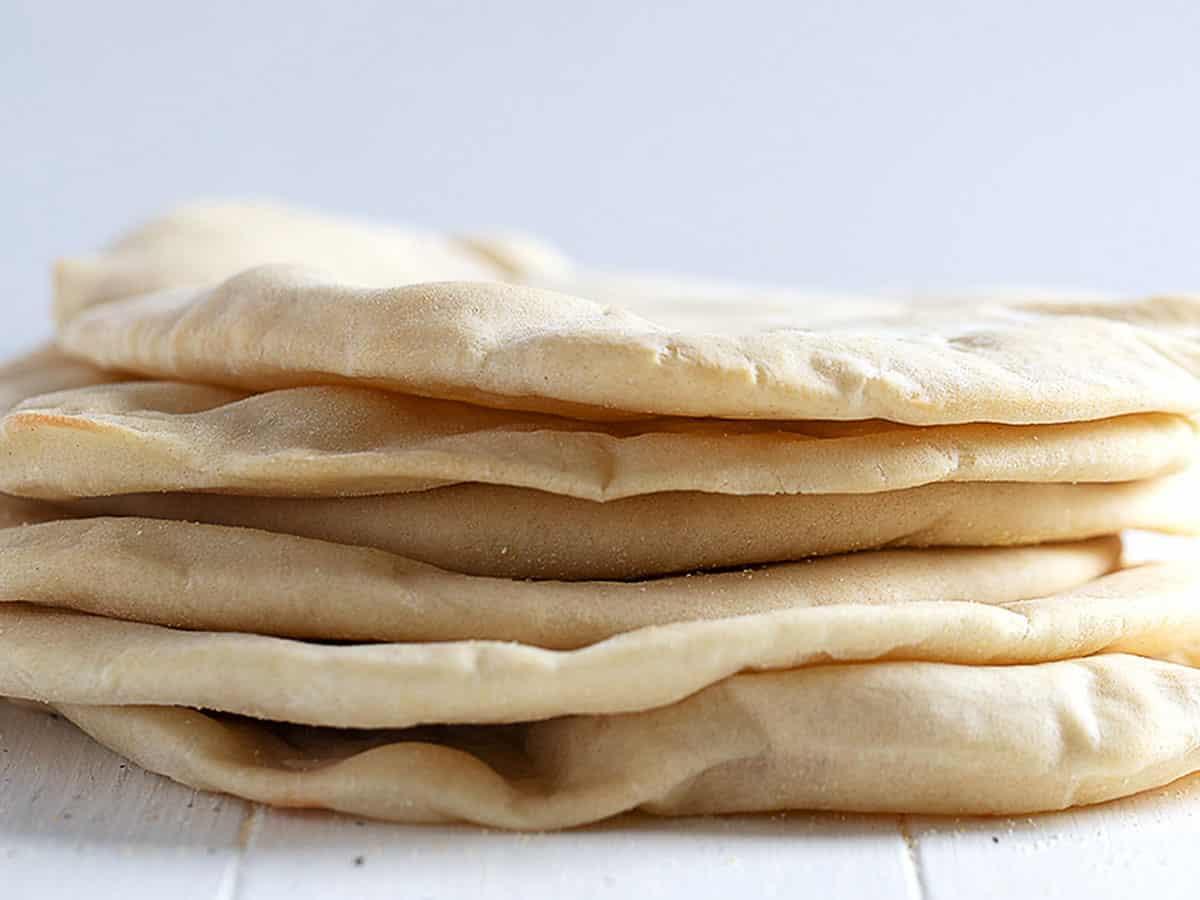 homemade pita bread with pockets stacked