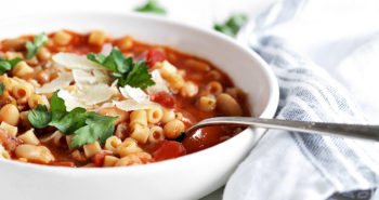 pasta e fagioli in white bowl with spoon
