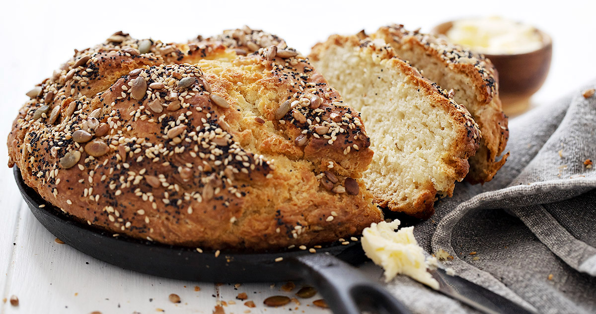 seeded no yeast bread sliced, with butter