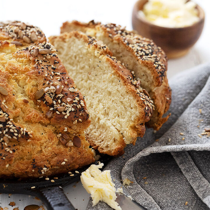seeded no yeast bread in skillet sliced with butter