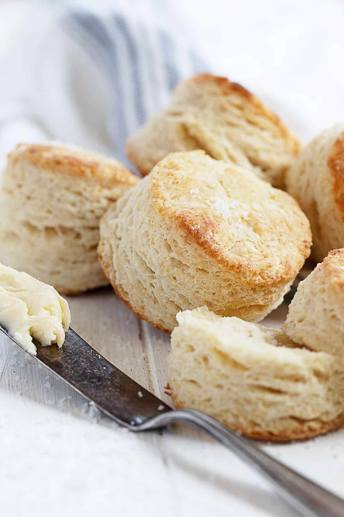 flaky buttermilk biscuits with knife and butter