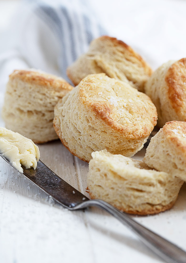 side view of baked biscuits with a knife and butter in portrait view