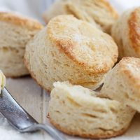 side view of baked biscuits with a knife and butter