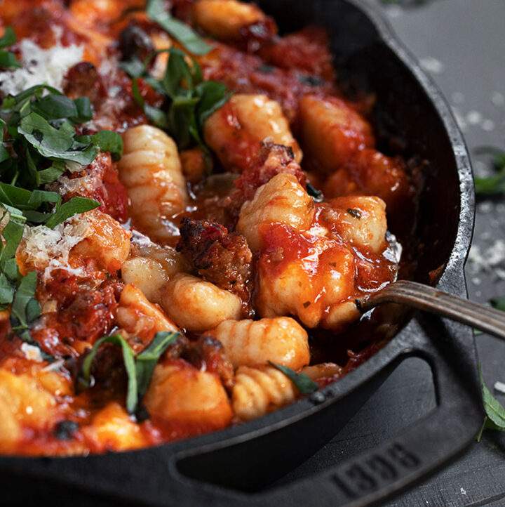 baked gnocchi with sausage in skillet