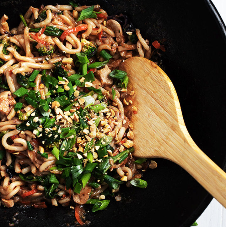 spicy peanut noodles in a cast iron wok