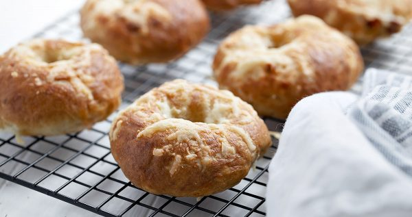 sun-dried tomato asiago bagels on cooking rack from above