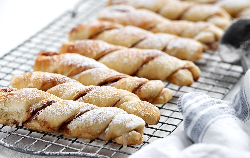 cinnamon twists lined up on a cooling rack