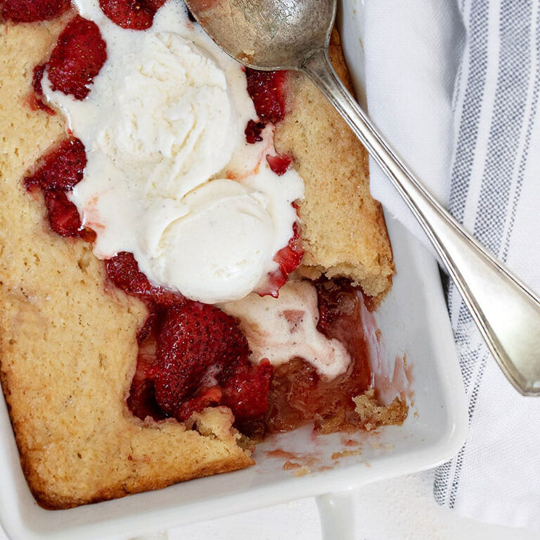 strawberry spoon cake in pan with spoon