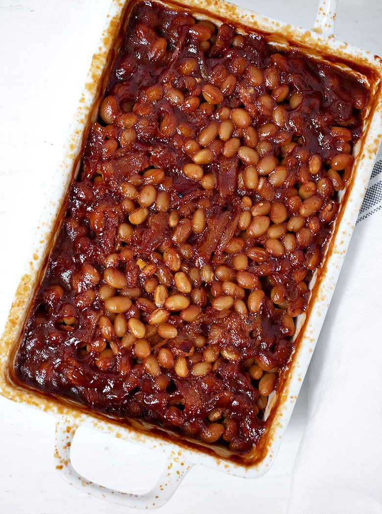 bbq baked beans in white casserole dish
