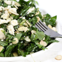 feta almond salad on white plate with fork
