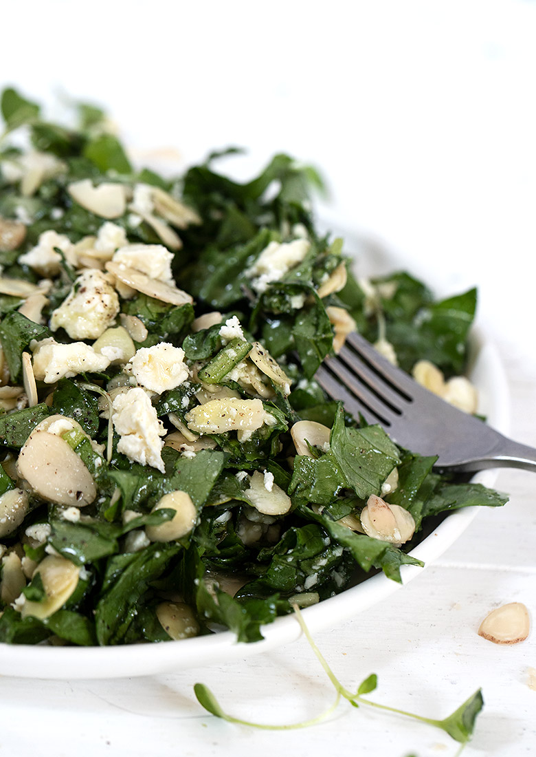 feta and almond salad on white plate with fork