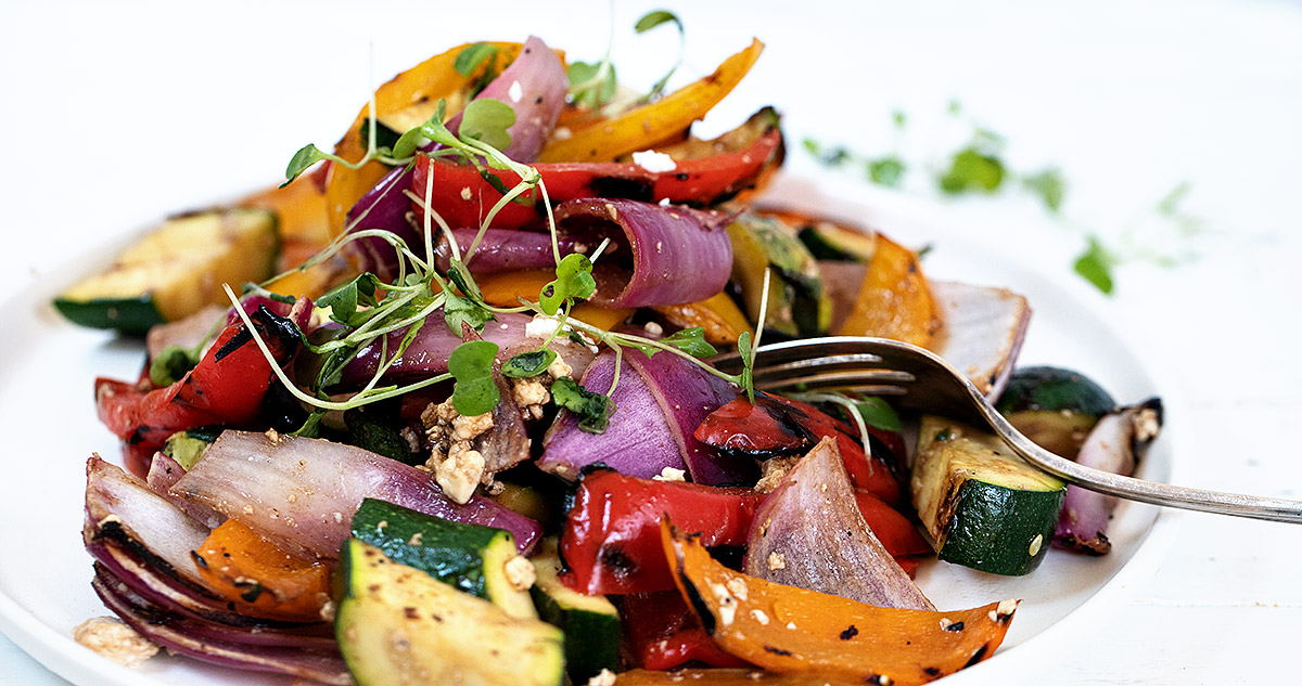grilled vegetable salad in white bowl
