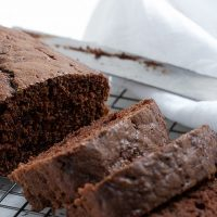 chocolate zucchini loaf slices on cooling rack
