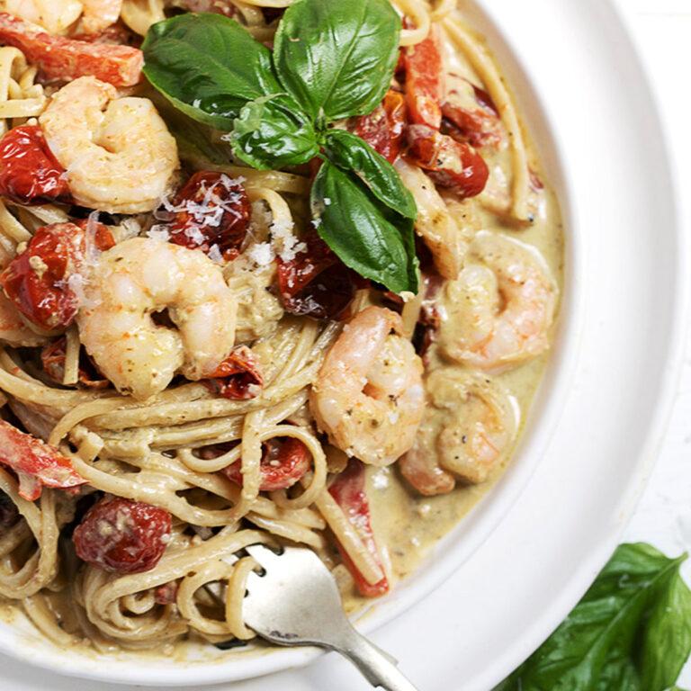 creamy shrimp pesto pasta in bowl