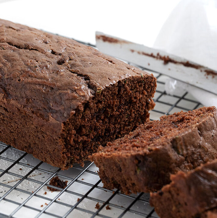chocolate zucchini loaf sliced on cooling rack