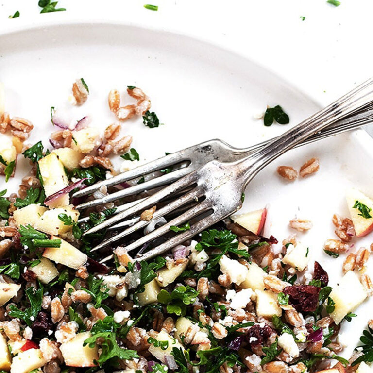 Fall inspired tabbouleh salad on white plate with forks