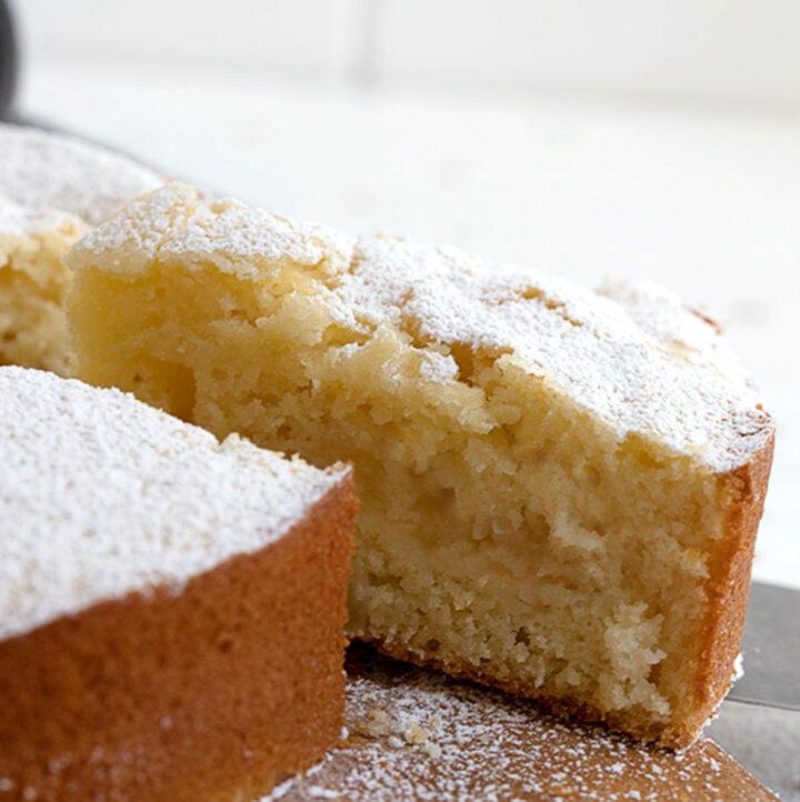 Italian apple cake sliced on cutting board