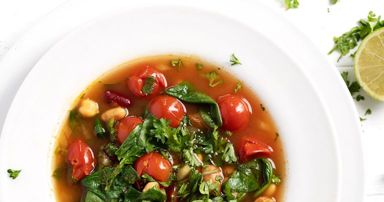 Moroccan bean soup in white bowl from overhead