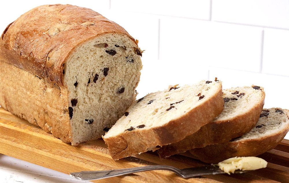 raisin bread sliced on cutting board