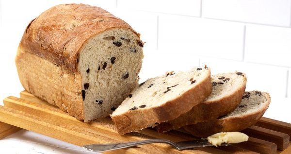 raisin bread sliced on cutting board